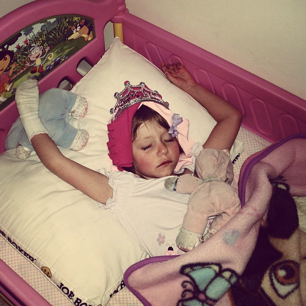 girl sleeping dressed up as princess