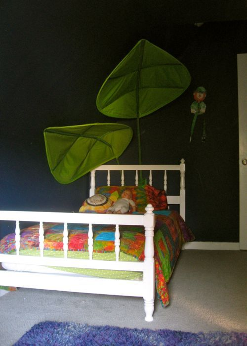 navy bedroom, white twin bed, ikea leaf canopy