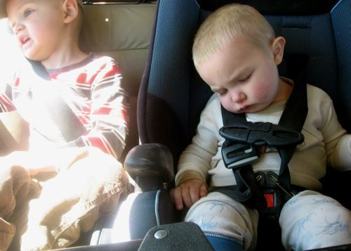 toddler sleeping in carseat, road trip with kids