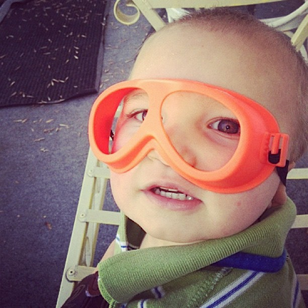 toddler in goggles