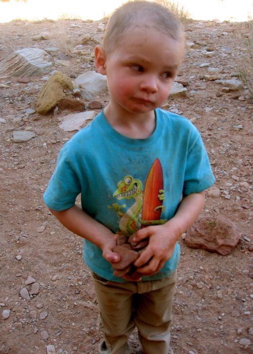 little boy holding rocks, hiking