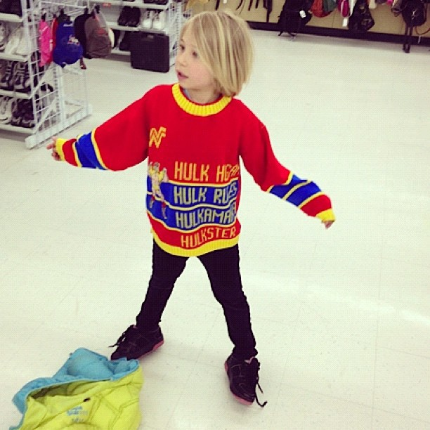 little girl in hulk hogan sweater