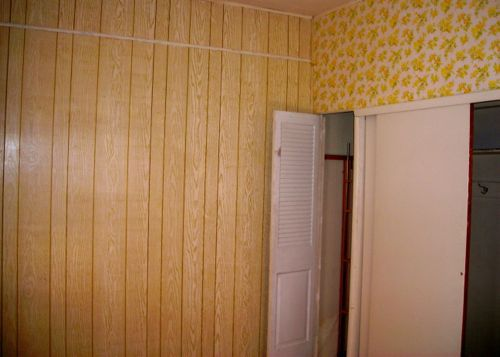 paneled bedroom before