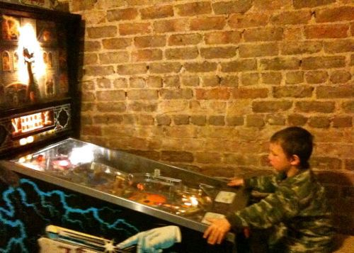 pinball machine exposed brick wall