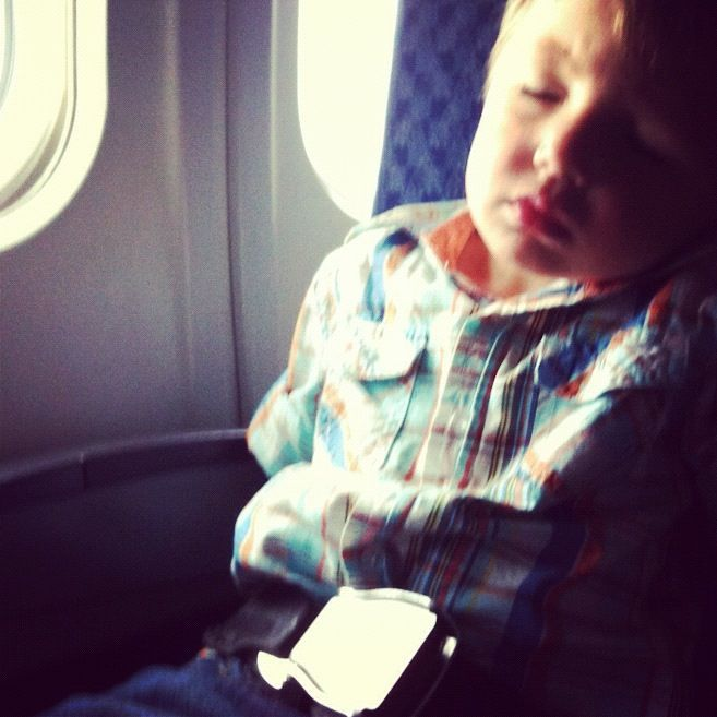 little boy sleeping on airplane instagram