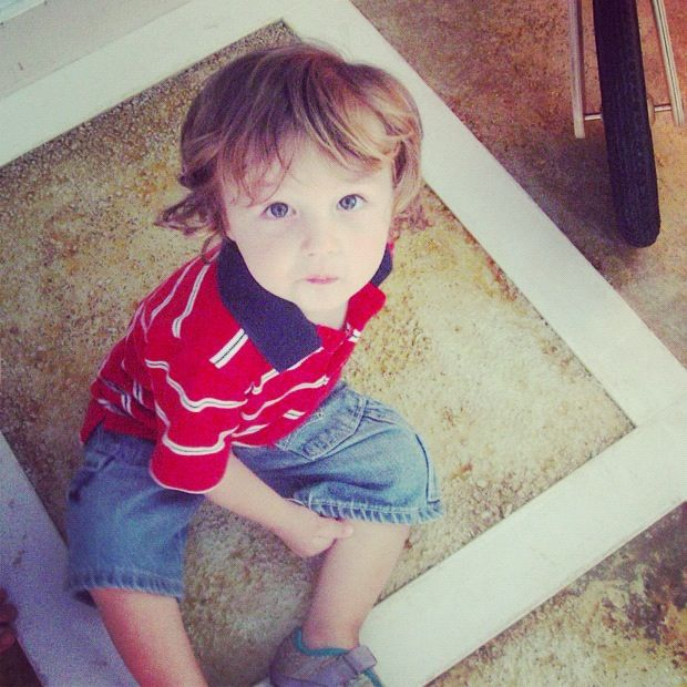 little toddler boy sitting on floor instagram