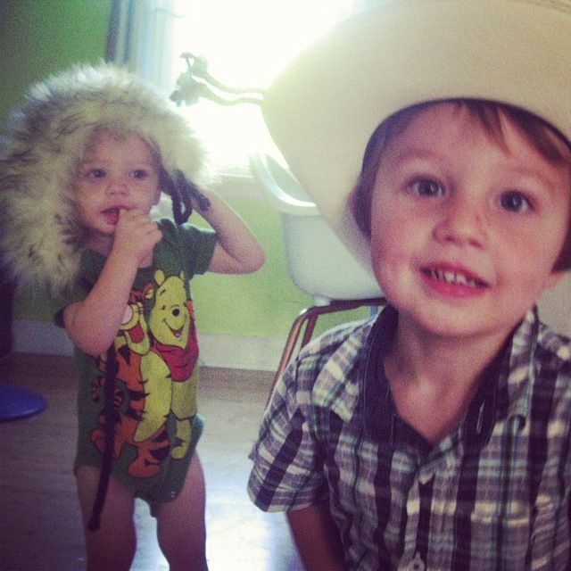 little toddler boys wearing cowboy and fuzzy hats instagram
