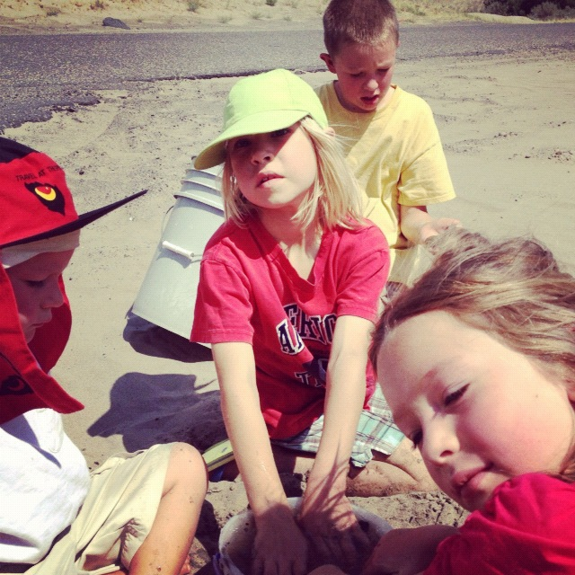 kids digging in sand instagram