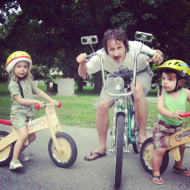 little girl and boy dad family bike ride balance bike skuut instagram