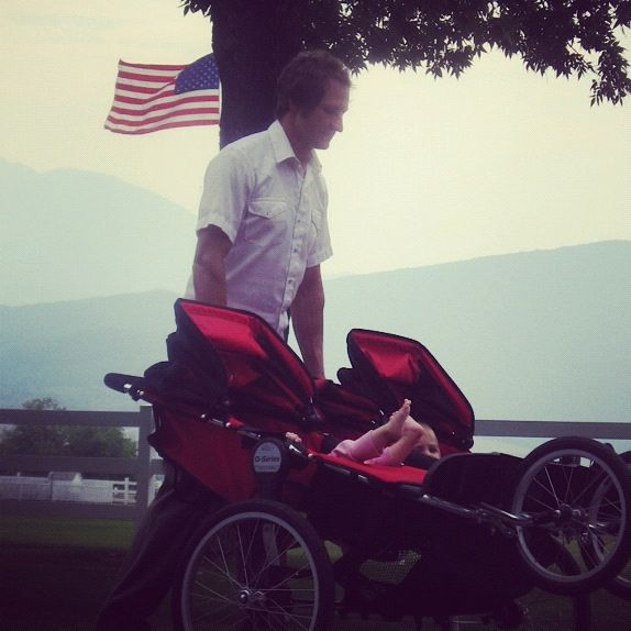 man triple jogging stroller american flag instagram
