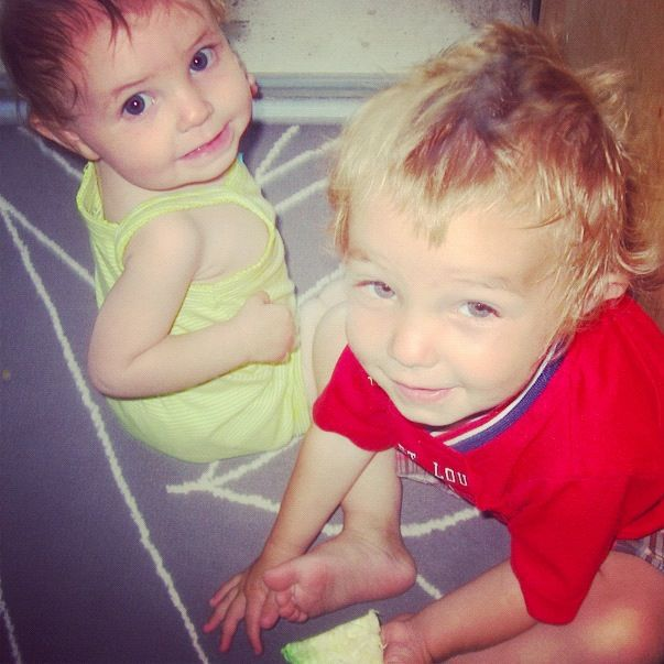 baby girl little boy siblings