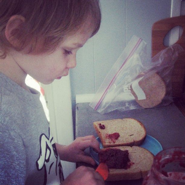little boy making jam sandwich instagram