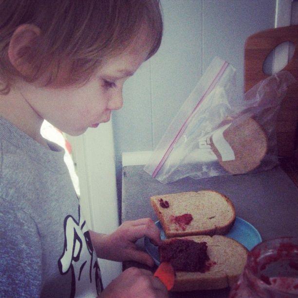 little boy making jam sandwich instagram