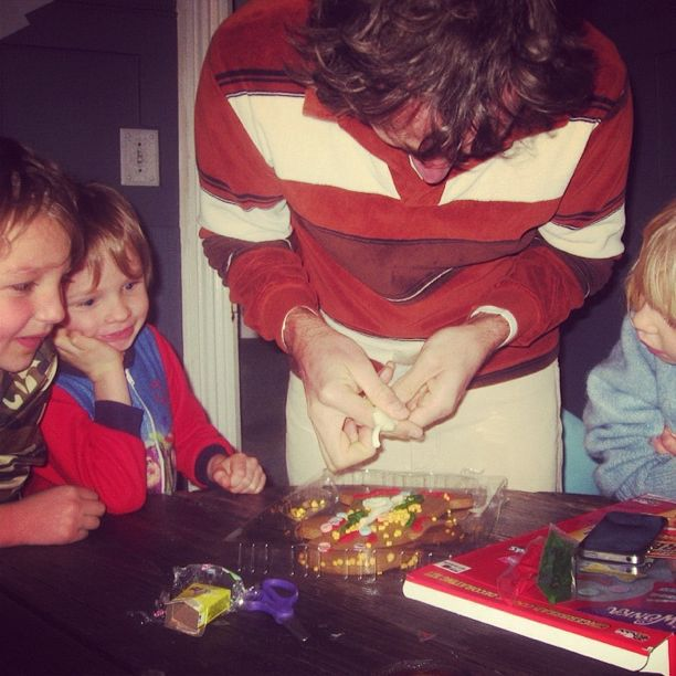 dad and kids decorating gingerbread man kit instagram