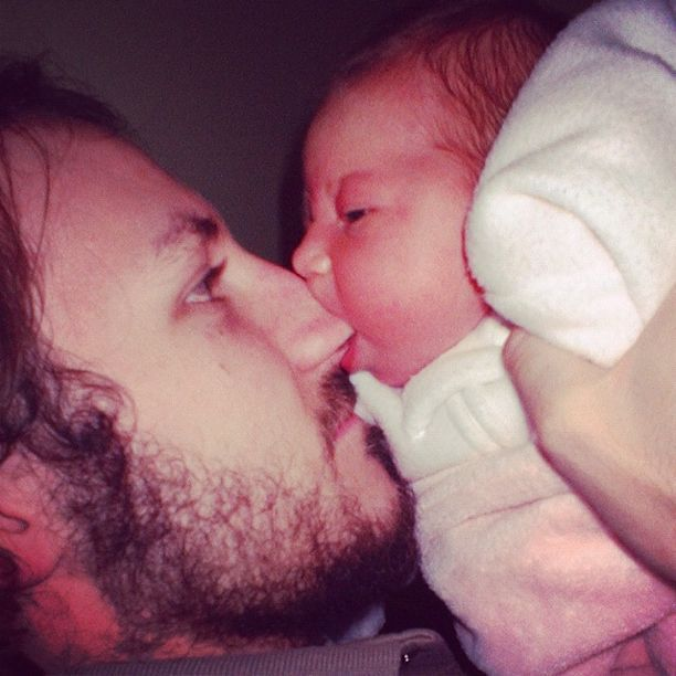 baby sucking on dad's nose instagram