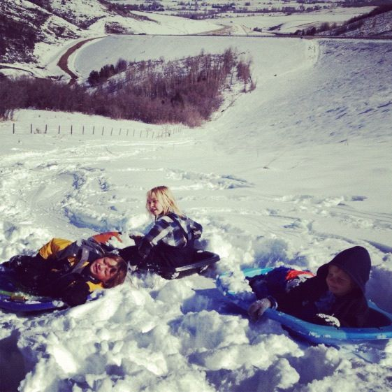 kids sledding instagram