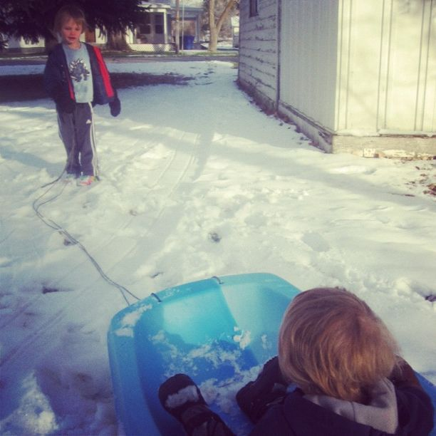brothers pulling sled snow instagram