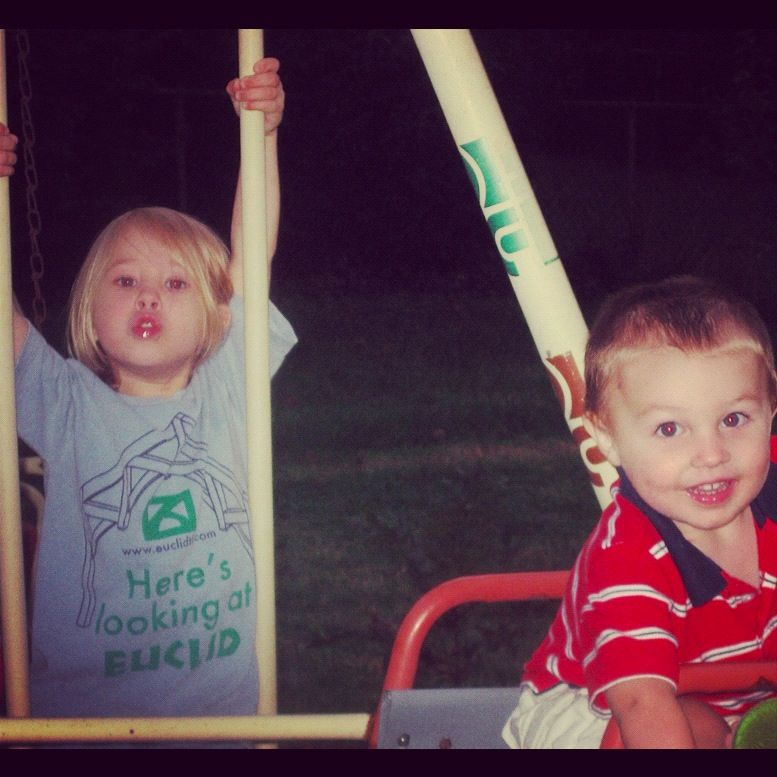 little boy and girl on swing set at night instagram