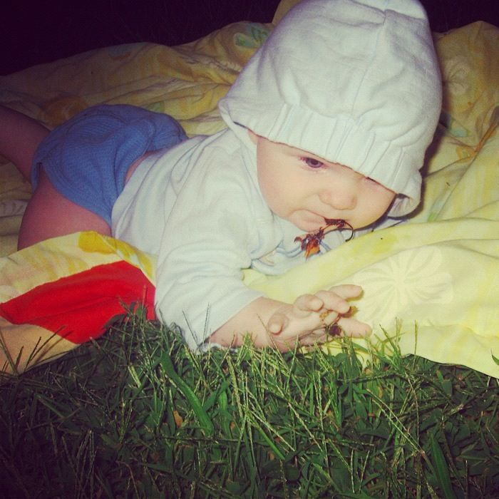 baby boy on blanket eating leaf instagram