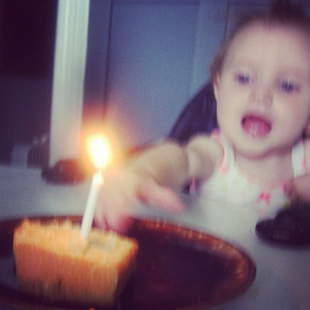 baby girl grabbing cake and candle instagram