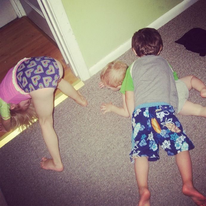 little boys and girl pretending to swim on floor instagram