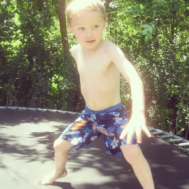 little boy on trampoline swimsuit instagram