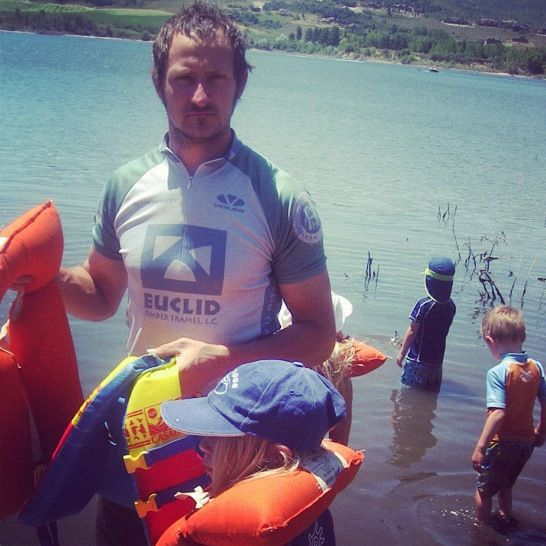 man getting life jackets on kids instagram