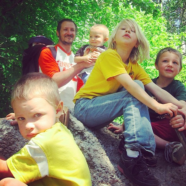 family hiking sitting on giant rock instagram