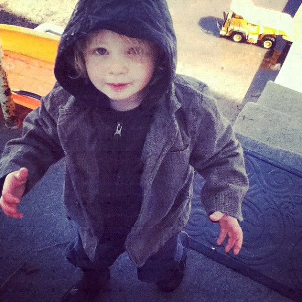 little boy in coat and rain boots instagram