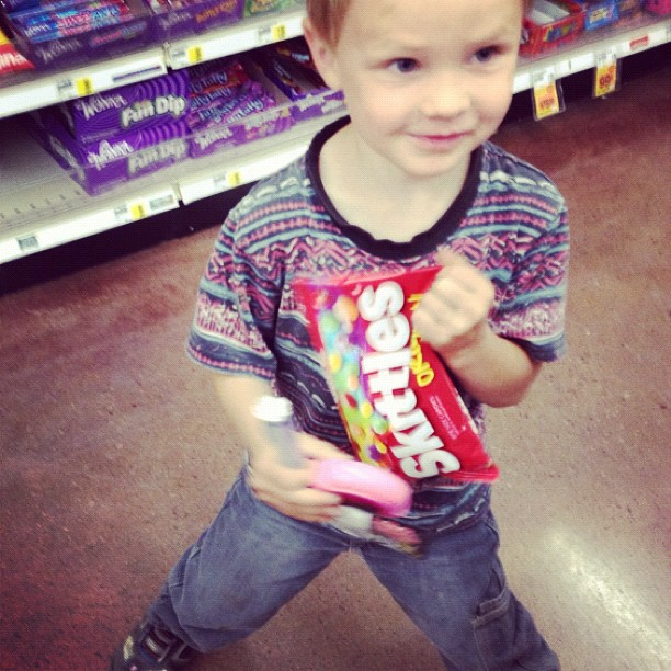 little boy holding candy aisle instagram
