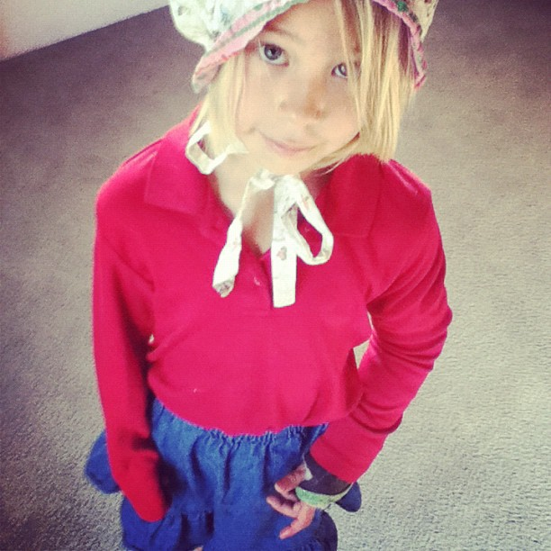 little girl dressed as pioneer