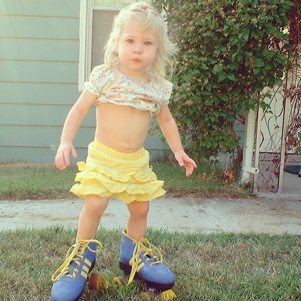 toddler girl wears moms roller-skates instagram