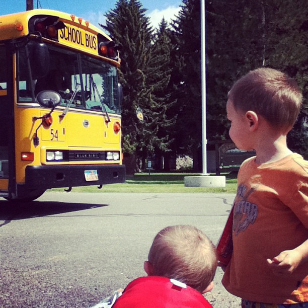 two little boys waiting for school bus instagram