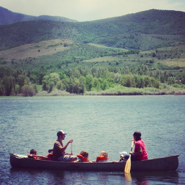 man woman lots of kids canoe lake instagram mountains