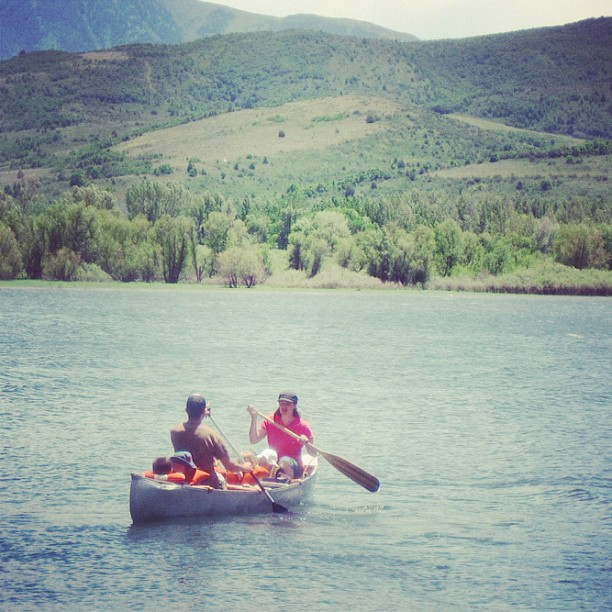 man woman lots of kids canoe lake mountains instagram