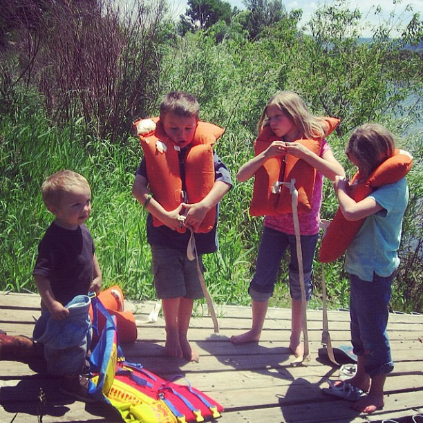 little boys and girls putting lifejackets on dock instagram