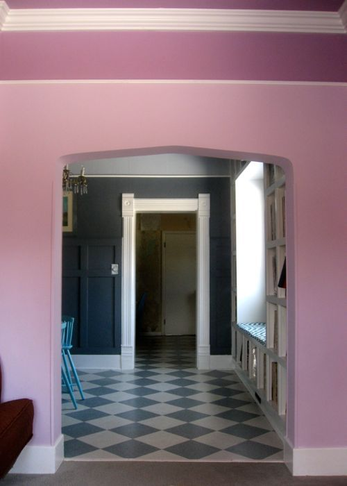arched doorway purple living room