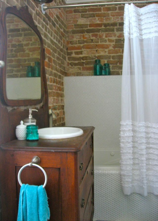 exposed brick wall bathroom