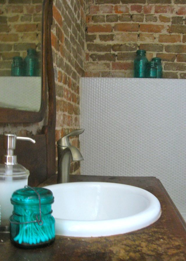 penny round tile bathroom exposed brick turquoise antique vanity dresser