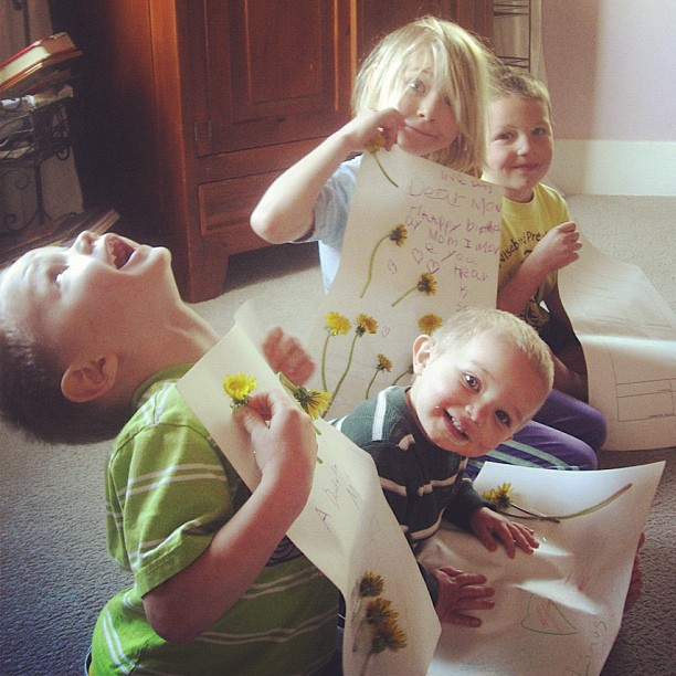 four kids with homemade birthday cards