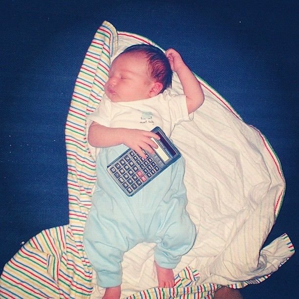 baby boy holding calculator