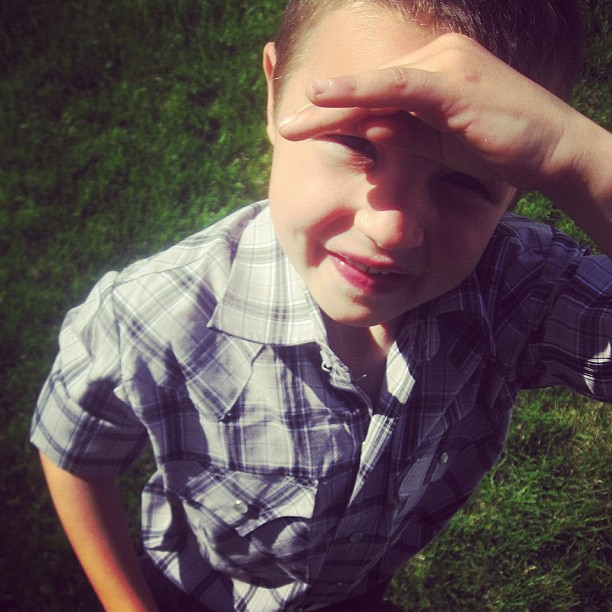 boy shielding eyes from sun instagram