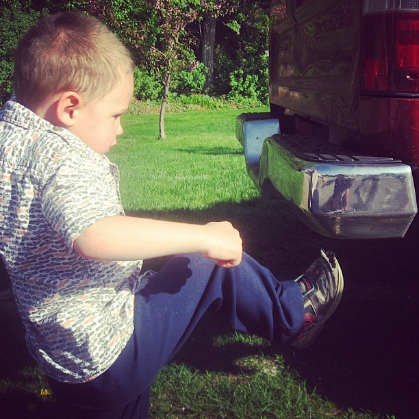 boy making reflection in bumper instagram