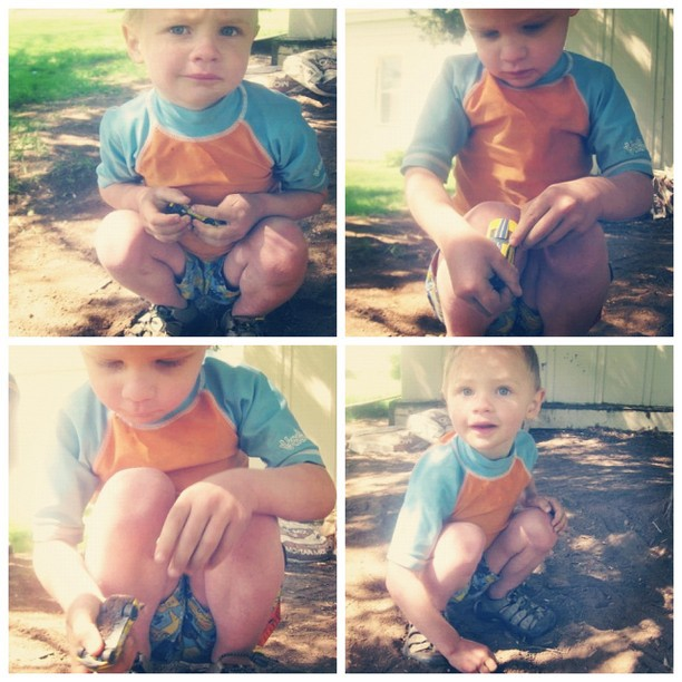 little boy playing with cars in dirt instagram