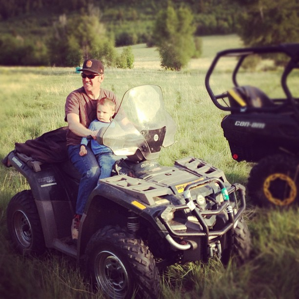 dad and little boy on quad runner four wheeler