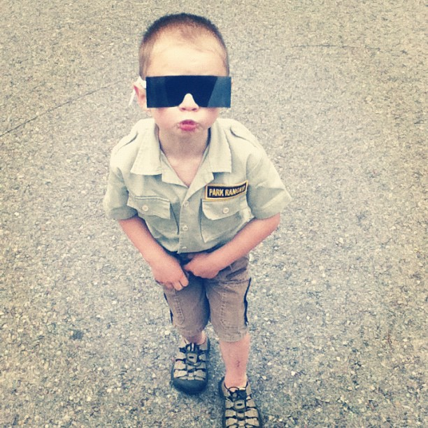little boy cataract glasses park ranger shirt