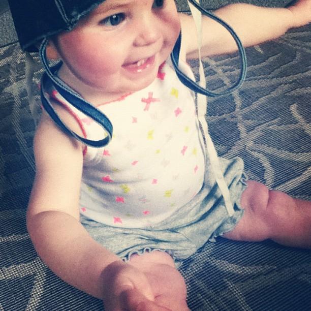 baby girl smiling sitting bag on head