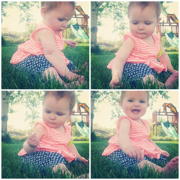 baby girl sits in grass instagram