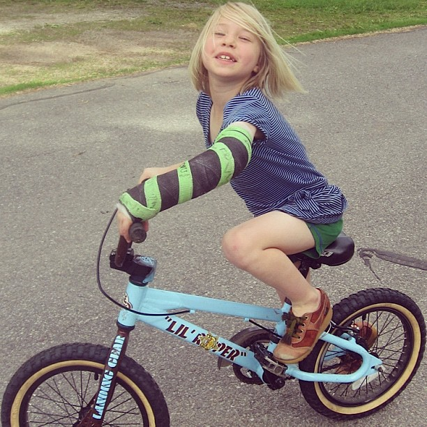 little girl in cast riding bike instagram
