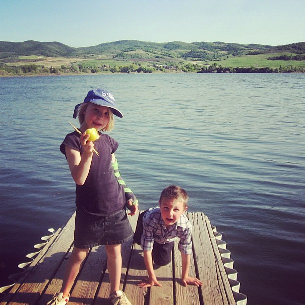 little boy and girl on lake dock mountains instagram